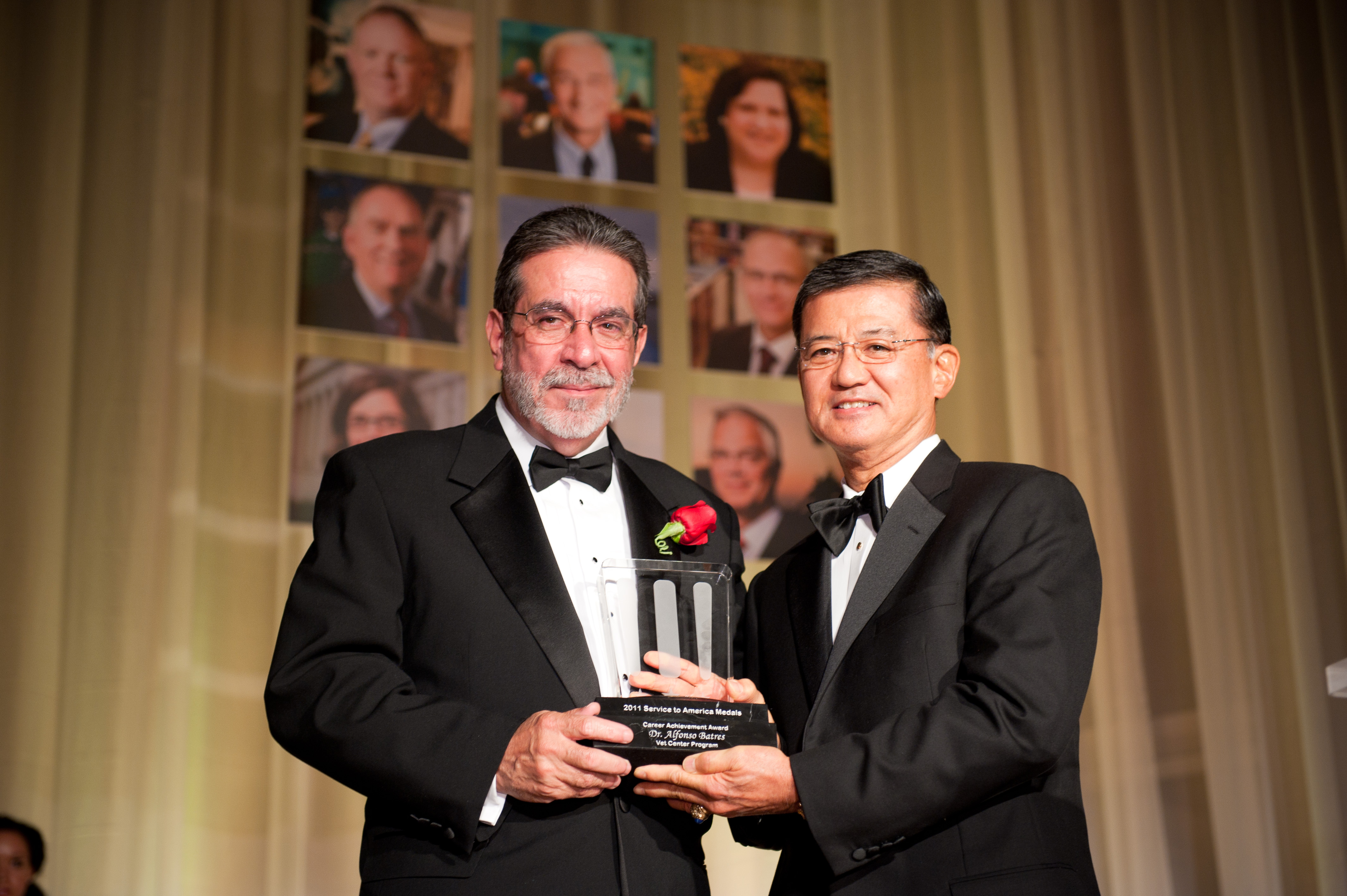 "Dr. Batres receiving ""Sammies"" award from Secretary Shinseki"