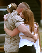 Returning Solider Hugging Family